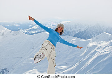 Young woman on the top of the mountain
