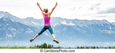 young woman on top of the mountain