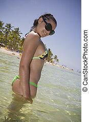 Young Woman on Tropical Beach - Beautyfull girl in a bikini...