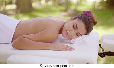 Young woman on vacation enjoying a spa treatment