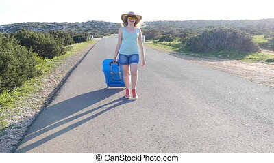 Young woman on vacation with a suitcase