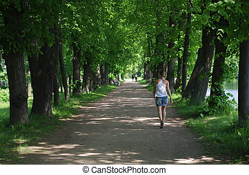 young woman on walkway in the park