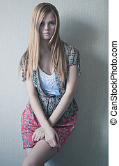 Young woman on wall background