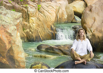 Young woman on waterfall background