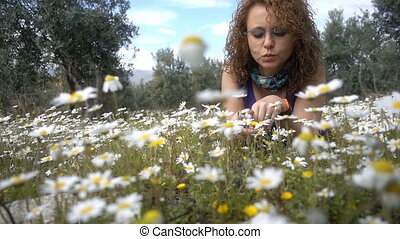 Young Woman on White Daisy Flowers