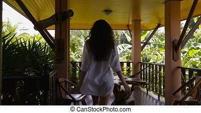 Young Woman Open Door Walking Out On Summer Terrace With Beautiful Tropical Landscape, Back Rear Of Beautiful Girl Enjoy Morning View