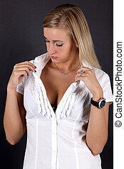 young woman opening shirt