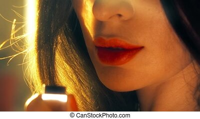 Young woman opens red lipstick. 4K shot - Young woman opens...