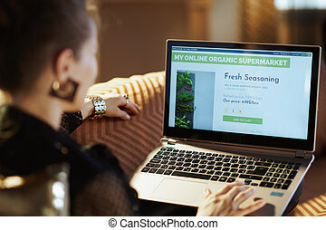 young woman ordering organic food online