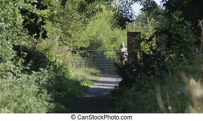 Young woman out running - Young woman running along a...