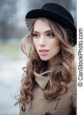 Young woman outdoors, closeup portrait
