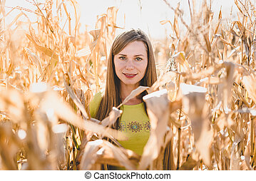 Young woman outdoors in a corn field