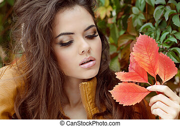 Young woman outdoors portrait. Makeup. Autumn Style.