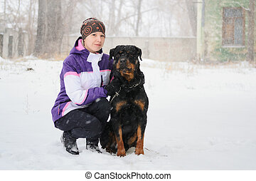 Woman outdoors with dog