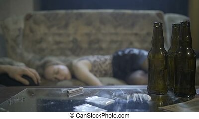 Young woman overdosed on the sofa at home