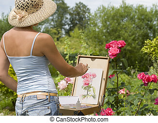 Young woman painting roses