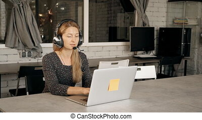 Young woman participating in webinar on programming. Female...