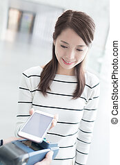woman pay by smart phone