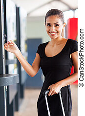 young woman paying parking ticket at airport