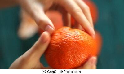 young woman peel tangerine mandarin hd