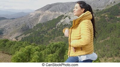 Young woman peering into the distance