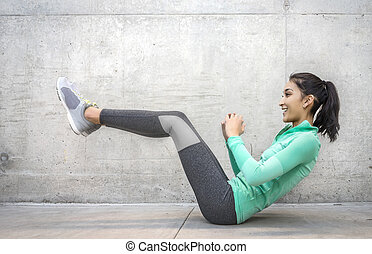 Young woman performing core crunch