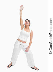 Young woman performing stretching exercise