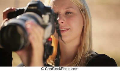 Young woman photographer at work