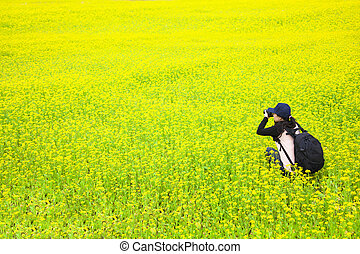young woman photographer making pictures of flowers