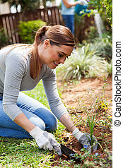 young woman planting