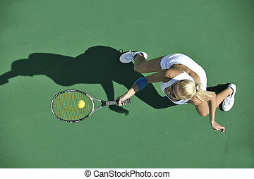 young woman play tennis outdoor - young fit woman play ...