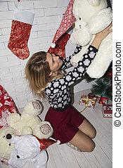woman play with teddy bear