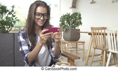 Young woman playing game on smartphone