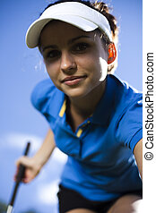 Young woman playing golf