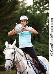 young woman playing horse-ball