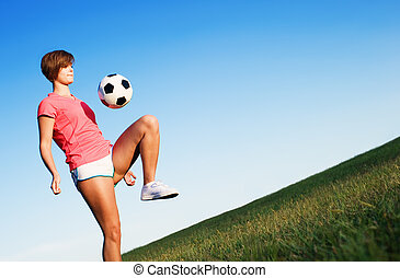 Young Woman Playing Soccer
