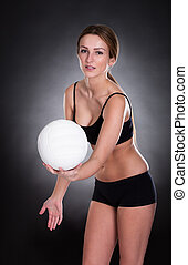 Young Woman Playing Volleyball