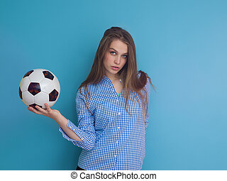 young woman playing with a soccer ball