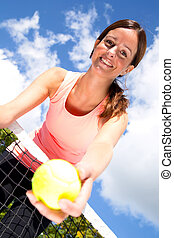 young woman playinjg tennis