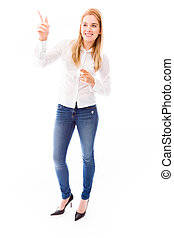 Young woman pointing and smiling