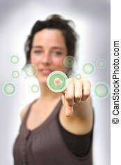 young woman pointing at a digital interface