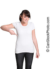 Young woman pointing at her plain white T-shirt