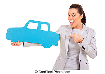 young woman pointing car symbol