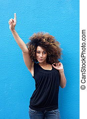 Young woman pointing finger up