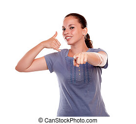 Young woman pointing looking at you saying call me