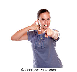 Young woman pointing-looking at you saying call me