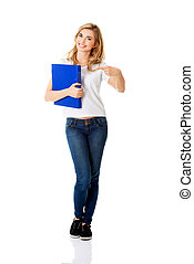 Young woman pointing on her binder