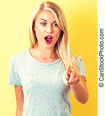 Young woman pointing something