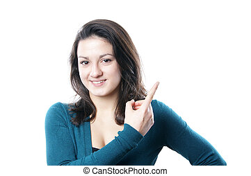 young woman pointing to copyspace