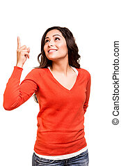 Young woman pointing up